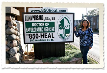 Dr. Persaud with Sign